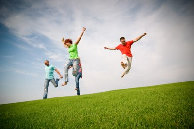 young friends jumping and running